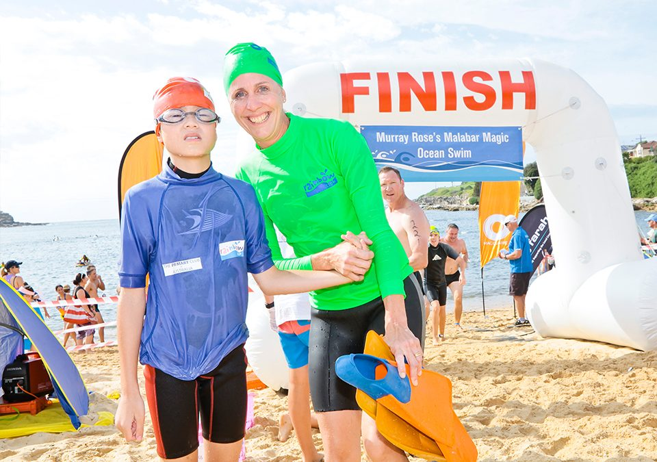Jpsh with his teacher in front of the Malabar Magic finish line